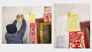 종교를 배척하라고 주민을 선동하는 내용이 담긴 전단지를 붙이는 마을 주민